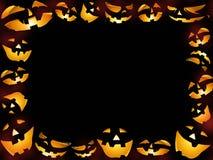 Marco del fondo de las caras de las calabazas del feliz Halloween Fotografía de archivo