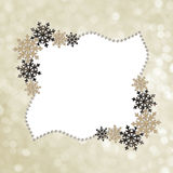 Marco del invierno con los copos de nieve y las gotas de la decoración Foto de archivo libre de regalías