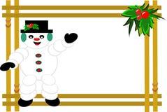Marco del muñeco de nieve y del acebo Imagenes de archivo