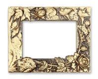 Marco del oro con un modelo decorativo en el fondo blanco foto de archivo libre de regalías