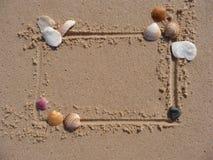 Marco del shell y de la arena Foto de archivo libre de regalías