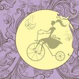 Marco del vintage con una muchacha en la bicicleta Foto de archivo