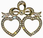 Marco dorado de la foto integrado con los diamantes artificiales en la forma de corazones Foto de archivo