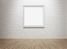 Marco en blanco en la pared Imagen de archivo libre de regalías