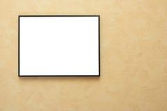 Marco en blanco sobre la pared amarilla Imagen de archivo libre de regalías