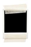 Marco en blanco sujetado con cinta adhesiva Imágenes de archivo libres de regalías