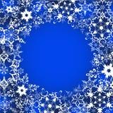 Marco festivo del invierno con los copos de nieve adornados Imagen de archivo