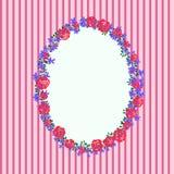 Marco floral en un fondo rayado rosado Imagenes de archivo