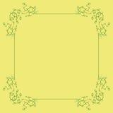 Marco floral verde en un fondo amarillo Fotos de archivo libres de regalías