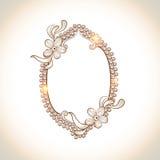 Marco formado oval con la decoración floral Foto de archivo libre de regalías
