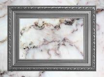 Marco gris de la foto del vintage del marco en el fondo de mármol de la pared de piedra Imágenes de archivo libres de regalías