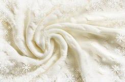 Marco hecho punto blanco doblado de la tela escocesa y de los copos de nieve Foto de archivo libre de regalías
