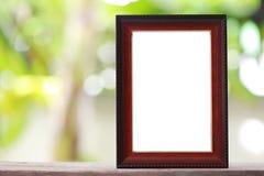 Marco moderno puesto en un piso de madera Imágenes de archivo libres de regalías