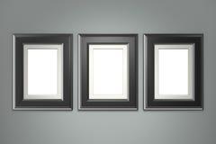 Marco negro en la pared gris imagen de archivo libre de regalías