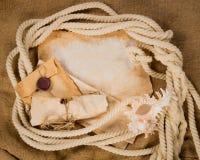 Marco original de la cuerda con los papeles viejos Foto de archivo libre de regalías