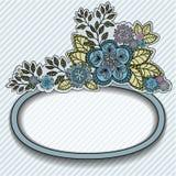 Marco oval con las flores azules Foto de archivo libre de regalías