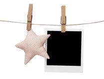 Marco polaroid en blanco de la foto con la estrella Fotos de archivo libres de regalías