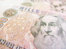 Marco Polo over an old one thousand Lire  Italian bill.  Royalty Free Stock Images