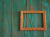 Marco rectangular con el espacio de la copia, en un fondo de madera auténtico hermoso Imagen de archivo libre de regalías