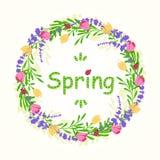 Marco redondo de la primavera con las flores y las hojas Imagenes de archivo
