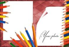 Marco rojo con los lápices Fotografía de archivo libre de regalías