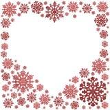 Marco rojo de la forma del corazón de los copos de nieve en blanco fotografía de archivo libre de regalías
