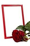 Marco rojo de la foto con el roze rojo Fotos de archivo libres de regalías