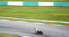 Marco Simoncelli speeding at cornering Royalty Free Stock Photography