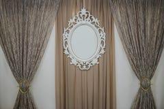 Marco tallado exquisito en la pared Foto de archivo libre de regalías