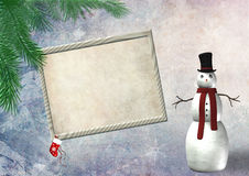 Marco vacío de la Navidad con un muñeco de nieve Imagen de archivo