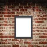 Marco vacío en una pared de ladrillo Foto de archivo libre de regalías