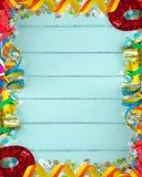 Marco vacío para el carnaval en el fondo de madera Fotos de archivo libres de regalías