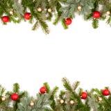 Marco verde de la ramita del abeto con las bolas de la Navidad Fotografía de archivo