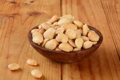 Marcona almonds. A wooden bowl of marcona almonds with rosmary Stock Photos