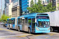 Marcopolo Gran Viale. SANTIAGO, CHILE - NOVEMBER 13, 2015: Blue articulated city bus Marcopolo Gran Viale in the city street Royalty Free Stock Photography