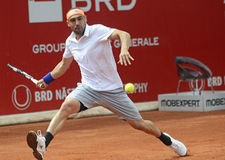 Marcos Baghdatis. ATP Tennis player Marcos Baghdatis pictured in action during his  ATP 250 tournament BRD Nastase Tiriac Trophy game against Steve Darcis Stock Photography