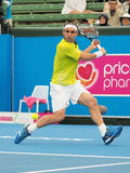 Marcos Bahdatis running for a backhand Stock Images