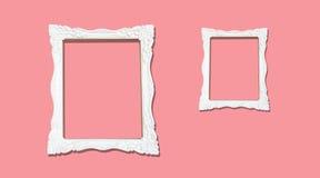 Marcos blancos de la vendimia en la pared rosada Foto de archivo