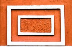 Marcos blancos del vintage en la pared anaranjada Fotografía de archivo