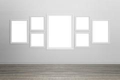 Marcos blancos vacíos en la pared Imágenes de archivo libres de regalías
