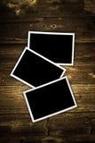 Marcos de la foto en el fondo de madera Foto de archivo