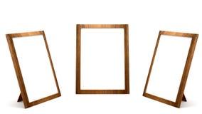 Marcos de madera de la foto en el fondo blanco Fotografía de archivo