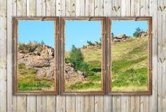Marcos de madera del granero viejo en la pared de madera Imágenes de archivo libres de regalías