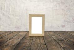 Marcos de madera en blanco en el piso de madera marrón Fotos de archivo