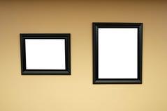 Marcos de madera en blanco en la pared Foto de archivo