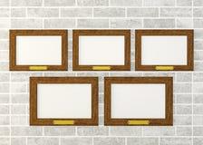Marcos de madera en blanco en la pared Imagen de archivo libre de regalías