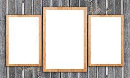 Marcos de madera en la pared de madera Imagenes de archivo