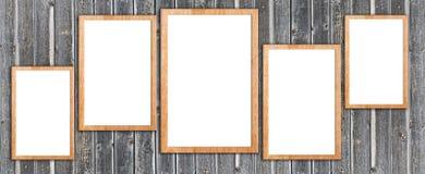 Marcos de madera en la pared de madera Fotografía de archivo