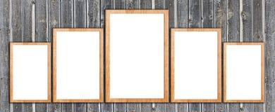 Marcos de madera en la pared de madera Foto de archivo libre de regalías