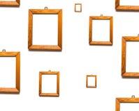 Marcos de madera en la pared blanca Muchos marcos Fotos de archivo libres de regalías